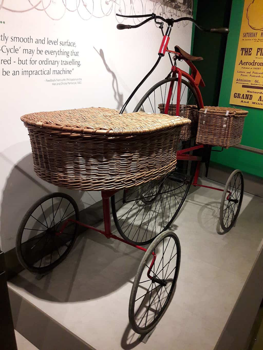 Pentacycle in London Postal Museum with wicker baskets on front and back