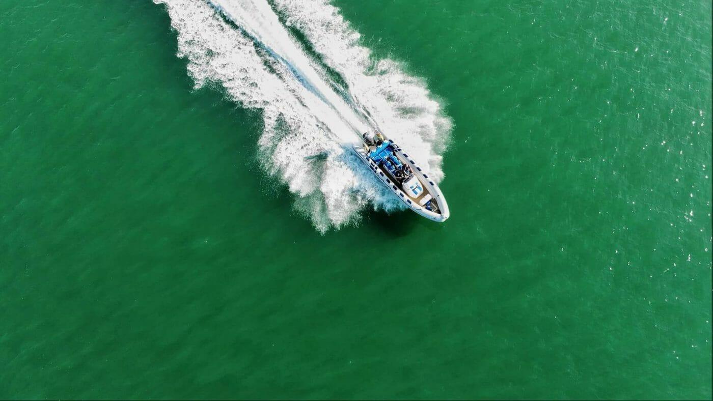 RIB boat speeding along water