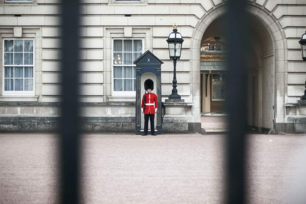 Guard in red at Buckingham Palace