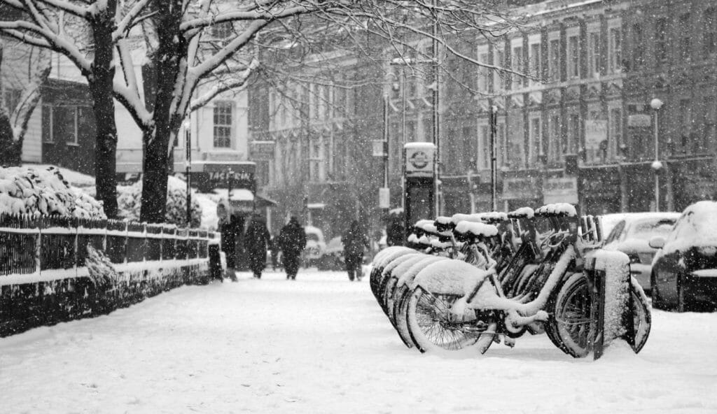 A row of bikes covered in snow in London