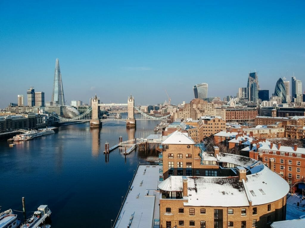 View of London with the River Thames and The Shard, with light snow on the rooftops