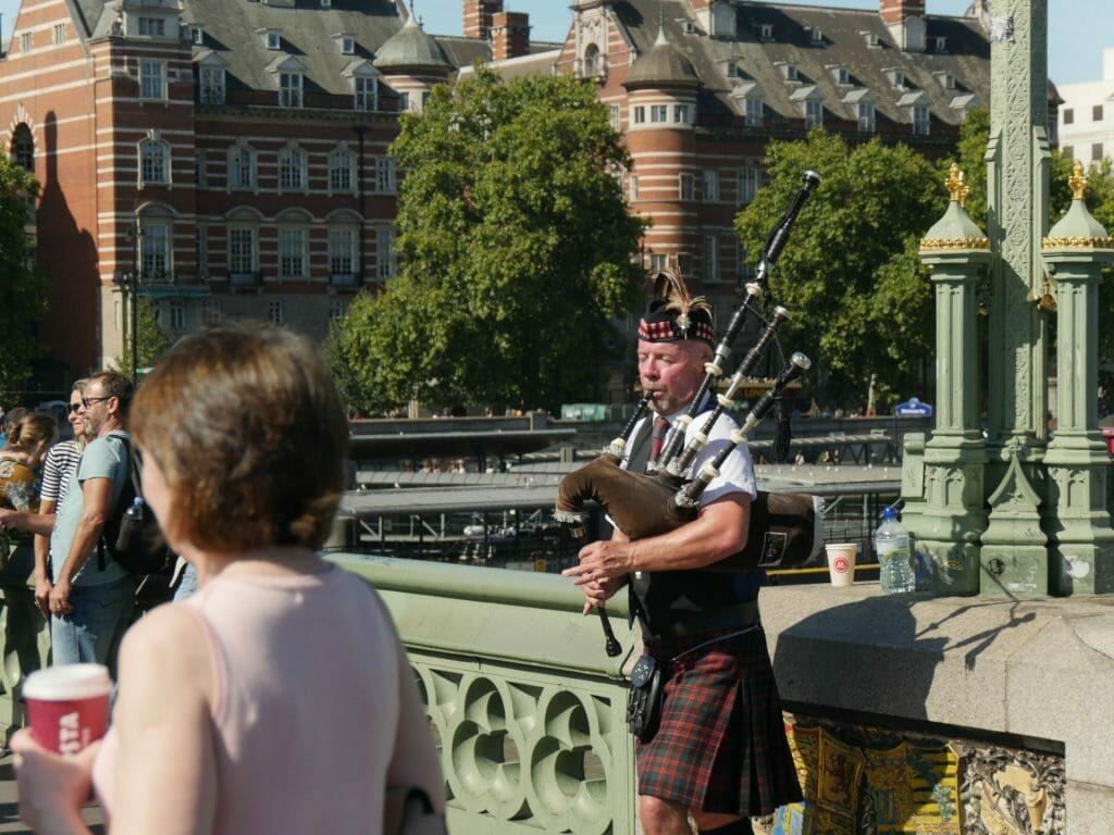 Man playing bagpipes in London